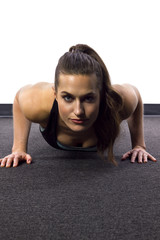 young Caucasian woman doing push ups