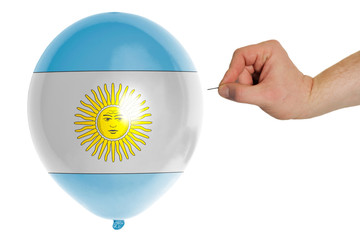 Bursting balloon colored in  national flag of argentina