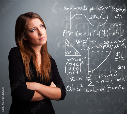 Beautiful school girl thinking about complex mathematical signs