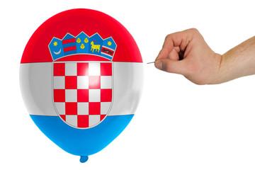 Bursting balloon colored in  national flag of croatia