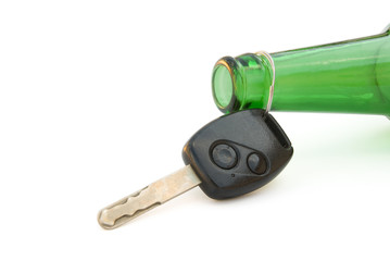 drunk driving conceptual, key and beer bottle with clipping path