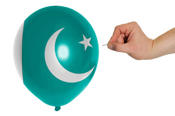 Bursting balloon colored in  national flag of pakistan