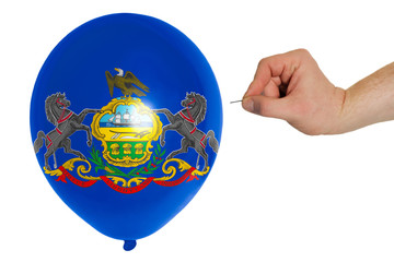 Bursting balloon colored in  flag of american state of pennsylva