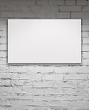 Image of blank billboard over white brick wall