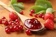 Strawberry jam and berry fruits.