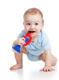 smiling boy baby  with musical toys. Isolated on white backgroun