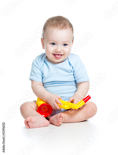kid playing musical toy isolated on white