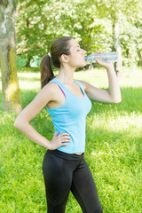 Fitness girl drinking water