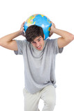 Man holding a globe on his back
