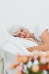 Peaceful woman sleeping in bed