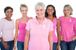 Diverse group of women wearing pink tops and breast cancer ribbo