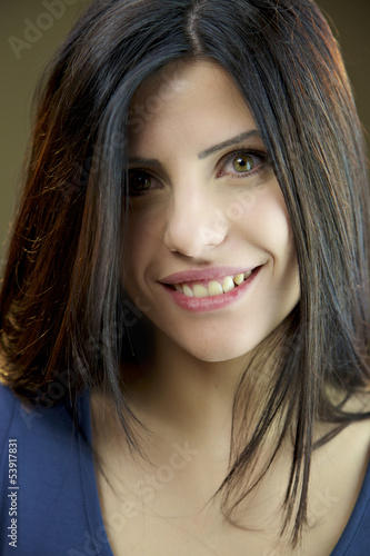 Portrait of happy female model with green eyes