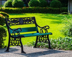 Green Bench in the Sunshine Day