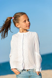 Cute girl with ponytails at seaside. poster