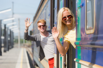 Couple Leaving for Vacation with Train