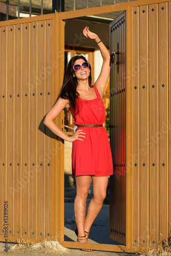 Woman opening door and welcoming