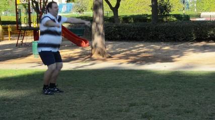 Fat man walking duck step