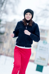 Young girl running on a cold winter day