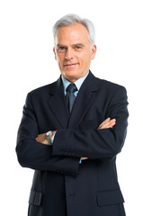 Portrait Of Senior Businessman With Hands Folded