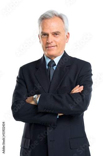 Portrait Of Senior Businessman With Hands Folded