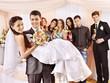 Groom  carries bride on his hands .