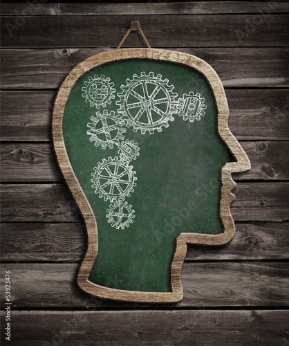 Human brain work drawn by chalk on blackboard