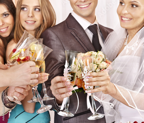 Hand holding wedding glass.