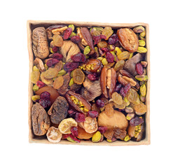 dry fruit and nuts in ceramic tray isolated on white background