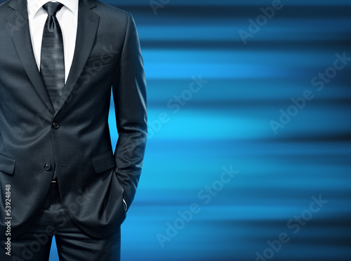 man in suit on a blue background