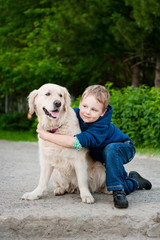 Little boy with a golden retriever