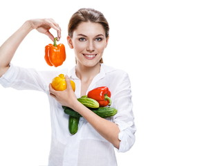 promo girl holding a paprika and cucumbers - isolated on white