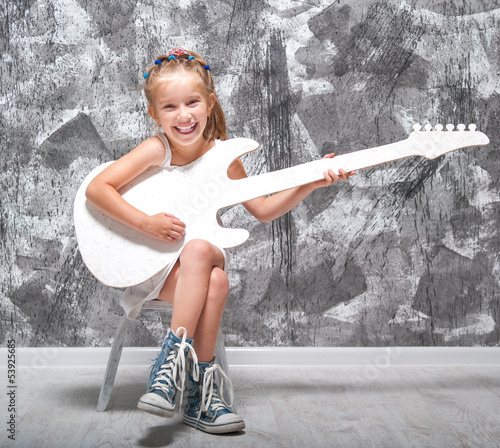 little girl with her guitar