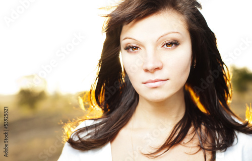 Young woman outdoors portrait. Summer