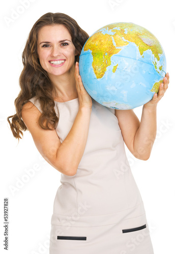 Smiling young woman looking out from earth globe