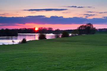 red sunset over Ijssel river
