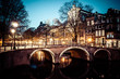 One of the famous canals of Amsterdam, the Netherlands at dusk. - 53929433