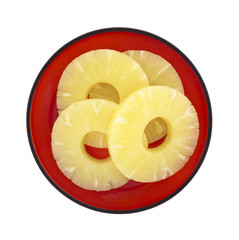 Pineapple rings on red dish