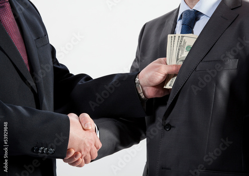 Giving a bribe into a pocket