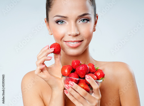 cheerful girl with strawberries