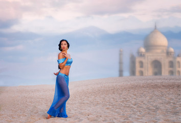 Belly dancer with an image of eastern palace in the distance