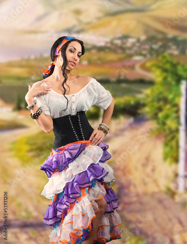 Portrait of Gypsy girl with Andalusian landscape