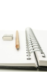 Spiral notebook with pencil and eraser