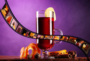 Mulled wine in glass with photographic film of drinks