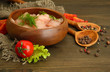 raw chicken meat in bowl, on wooden background