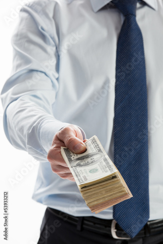 Businessman offering money to you