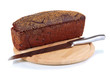 Black bread with sesame seeds and knife