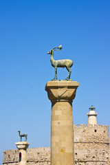 Rhodes Mandraki harbor with famous deer statues.