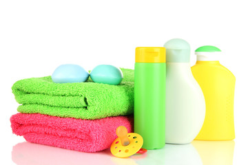 Baby cosmetics, soap and towels, isolated on white