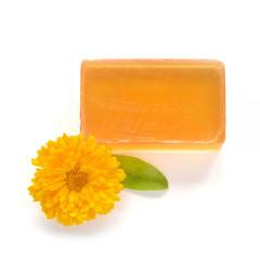 Orange handmade glycerin soap on white.
