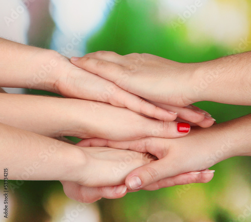 Many hands on nature background